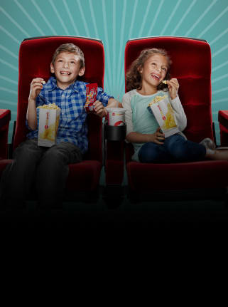 Kids enjoying a movie at AMC